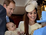 Britain's Queen Elizabeth II, right, speaks with Prince William and Kate Duchess of Cambridge