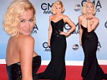 Blonde bombshell! Kellie Pickler brings some serious glamor to the CMA Awards with stunning Georges Chakra Couture gown and stylish wavy 'do