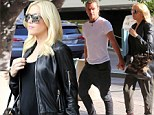 Gwen Stefani shows off her blossoming bump... and gets a helping hand from Gavin as she teeters around in sky high boots