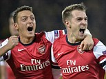 Winning moment: Aaron Ramsey (right) and Mesut Ozil celebrate the Welshman's second-half goal