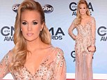 Carrie Underwood dazzles at the CMAs in a sequined dress that hugs her slim figure after revealing she keeps a food journal