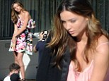 She won't be single for long! Miranda Kerr looks stunning in rooftop photoshoot after split from Orlando Bloom