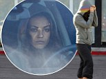 Will you be as shy a bride? Mila Kunis keeps her head down amid rumours of impending proposal from Ashton Kutcher