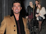 Thanks to the recent success of his summer smash Blurred Lines, it seems Canadian singer Robin Thicke is enjoying his new found attention as an object of female affection outside London restaurant Nobu.