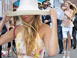 Hold on to your hat! Slender Whitney Port nearly gets blown away as she makes a stylish appearance at the Melbourne races