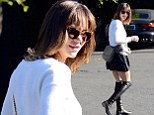 Katharine McPhee steps out in knee-high leather boots and mini-skirt after kissing scandal with married Smash director
