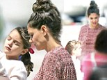 Katie Holmes bonds with Suri while Tom Cruise fights to prove he didn't 'abandon' his daughter