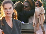 Maria Shriver shares a tender hug with good pal Oprah Winfrey after celebrating her 58th birthday with girls' lunch