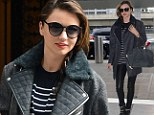 And she's off again! Miranda Kerr is chic in leather as she heads to London just one day after happy reunion with son Flynn