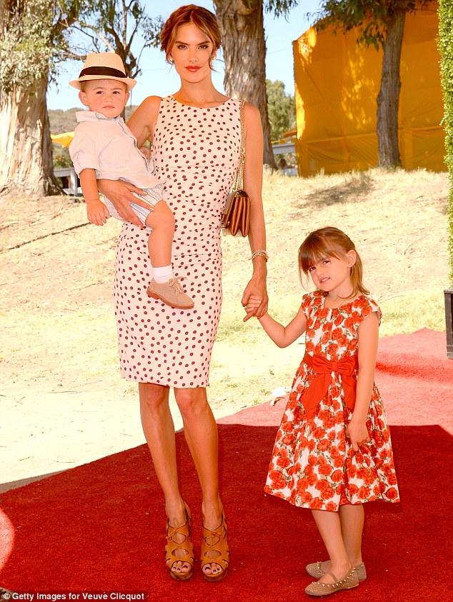 Model mum: The leggy brunette model posed with her adorable children, Anja and Noah