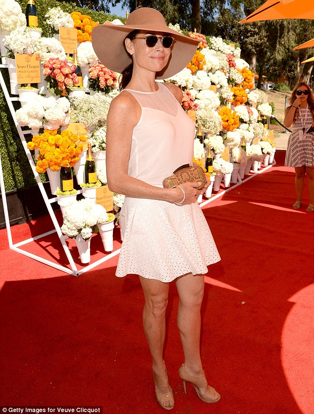 Sweet: Minnie Driver was cute in a short white dress and floppy hat for the day with the ponies