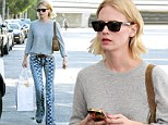 Pushing the fashion envelope! January Jones displays her singular street style in boldly patterned trousers while shopping