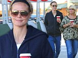 Bare-faced Heidi Klum hides her model figure in a tracksuit as she grabs coffee with mother Erna