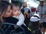 Her beautiful bundle of joy! Kim Kardashian showers little North with love while Kanye West pushes the stroller on family outing
