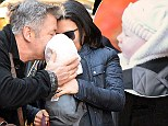 Alec Baldwin plants a kiss on tiny baby Carmen before locking lips with Hilaria as he waves goodbye to his favourite girls