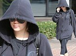 Khloe Kardashian looks grim in black post-workout after sharing message about 'suffering' and 'loss'... hasn't been seen with Lamar Odom in 10 days