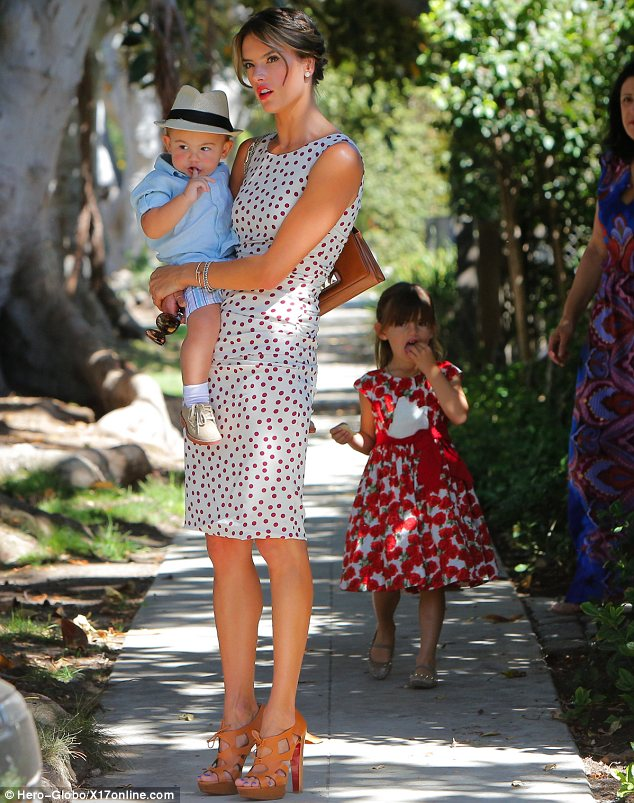 Off we go: Alessandra and her brood looked excited as they waited for their limo at home ahead of the bash