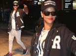 Going for the win: Rihanna steps out in a sporty Varsity jacket after earning her place among Madonna and Elvis with her 25th top ten hit on the Hot 100