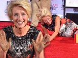 Dirty work: Emma Thompson held up her hands on Thursday after making a handprint during a ceremony immortalizing her with hand and footprints on the Hollywood Walk of Fame