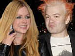 Avril Lavigne promotes her new self-titled album as her ex Deryck Whibley 'finally drops her last name' three years after divorce