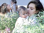 Smile for Mommy! Kim Kardashian gets playful with her baby girl North during family holiday