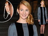 She's growing up fast! 13-year-old actress Sophie Nelisse wears an intricate earring chain at The Book Thief screening