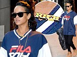 That's rubbing it in! Rihanna dresses up her casual outfit with flashy gold 'rich' necklace as she leaves New York hotel