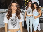 Working hard for the money! Kylie Jenner shows off her tiny waist in crop top as she models new PacSun collection with sister Kylie