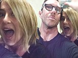 Jennifer Aniston looks thrilled with her new hair cut as she smiles and high fives in upbeat selfie with her stylist