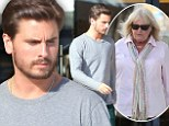 Retail therapy: Scott Disick keeps his head down during solitary shopping trip as he continues to mourn his mother's death