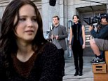 Firing up the sequel! Jennifer Lawrence and Josh Hutcherson pictured in rare behind-the-scenes shots filming new Hunger Games movie