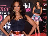 Tight and bright: Supermodel Tyra Banks shows off her worse self in a right and bright outfit choice