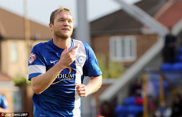 Mind the gap: Grant McCann was on target for second-placed Peterborough as their 2-0 win over Preston closed Orient's lead to a single point