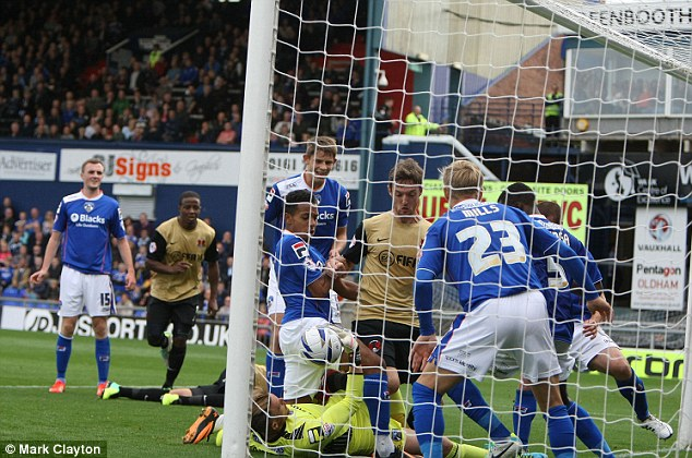 Scramble! Oldham somehow managed to prevent Orient scoring from this six-yard box melee