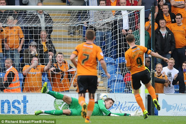 Spot on: Leigh Griffiths opened the scoring for Wolves with a penalty and celebrated in front of the large travelling support. Wolves went on to beat Colchester 3-0