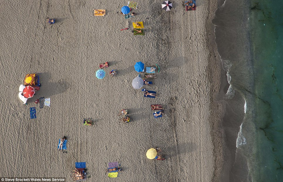 Naked ambition: Mr Brockett took this picture as he flew over a naturist beach in Vera, Spain