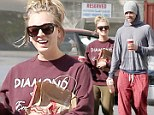 Domestic bliss! Kaley Cuoco gazes adoringly at fiance Ryan Sweeting as the scruffy couple make a coffee run in LA
