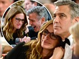 Lean on me! Close pals Julia Roberts and George Clooney giggle and hold hands during BAFTA event