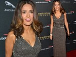 Sultry siren! Salma Hayek shimmers in a plunging grey sequin gown as she attends the BAFTA Britannia Awards