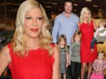 She's well red! Tori Spelling dons scarlet dress for book signing with her husband and four children