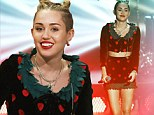 Bitten but not shy: Unlucky-in-love Miley Cyrus flashes midriff and long legs in heart-festooned outfit on German game show