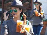 The show must go on! Kourtney Kardashian flashes a huge smile on drinks run as she and partner Scott Disick attempt to move on following death of his mother