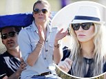 What marriage troubles? LeAnn Rimes perches on Eddie Cibrian's lap as Brandi Glanville stands to the side at sons' football game