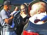 New parents Donald Faison and wife CaCee Cobb coo over their sweet boy Rocco as they enjoy family hike