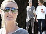 Mixing it up! Heidi Klum goes from workout wear to casual chic during a day out with daughters and Martin Kristen