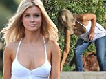 Dog day afternoon! Braless Joanna Krupa spills out of her plunging white top during playful romp with her pup