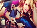 Your bum looks big in that: Candice also posed next to a gigantic image of herself lying on the floor