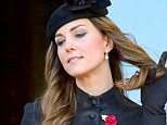 The Duchess of Cambridge plays with her hair during the Remembrance ceremony at the Cenotaph