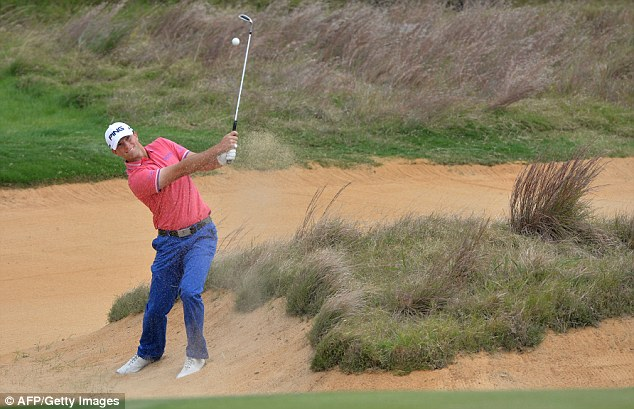 Sandy lie: Tournament leader Luke Guthrie plays from the bunker