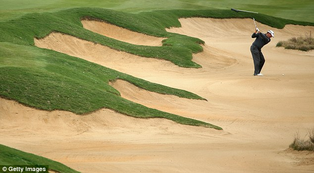 Trapped: Lee Westwood attempts to play out of a massive bunker at Lake Malaren Golf Club in Shanghai, China